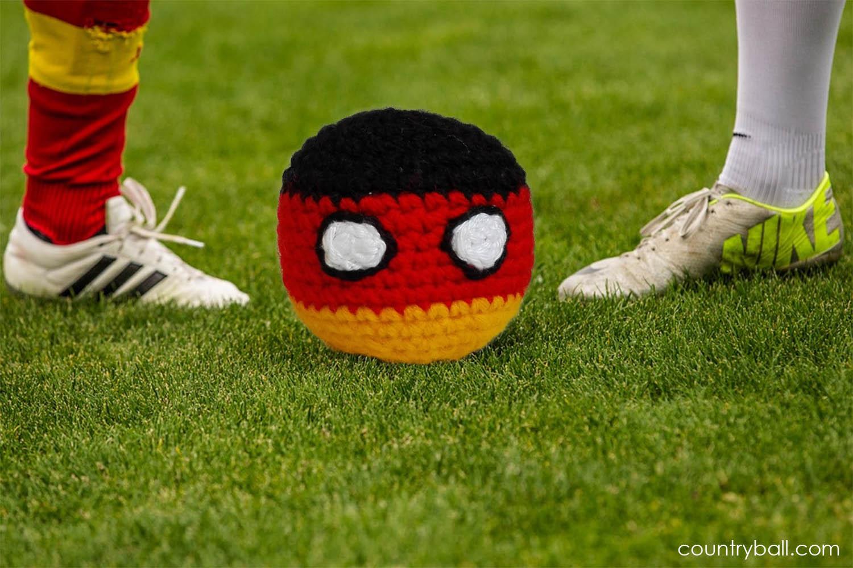 Bundesliga players playing with Germanyball