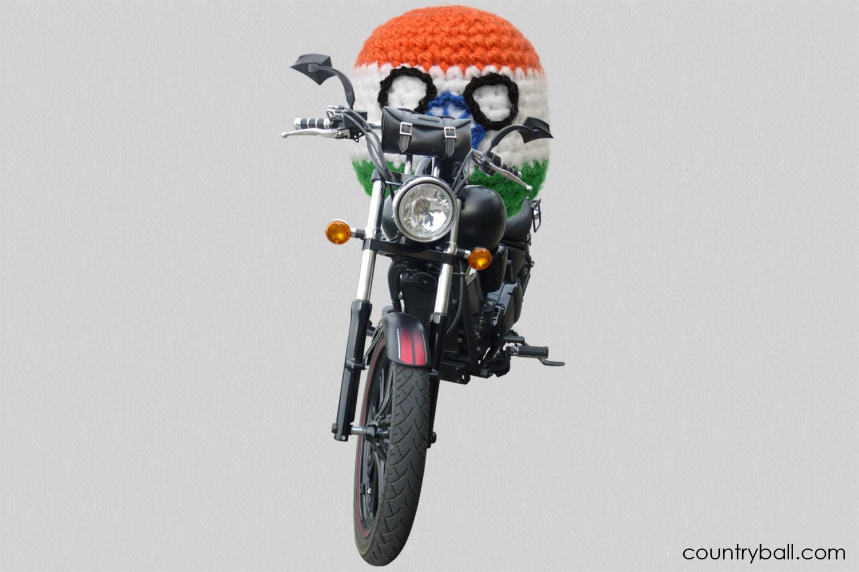 Indiaball riding a Motorbike
